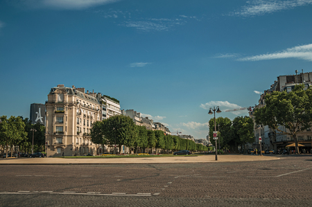Paris, northern France - July 07, 2017. Trees and buildings at the square in front of Les Invalides Palace with sunny blue sky in Paris. Known as one of the most awesome world's cultural center.