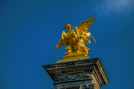 Golden statue adorning the Alexandre III bridge over the Seine River in Paris. Known as the