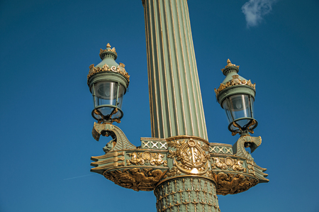 """Close-up of rich decoration in green and gold of lamp at the Place de la Concorde in Paris. Known as the """"City of Light"""", it is one of the most impressive cultural centers in the world. Northern France."""