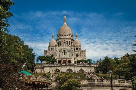 """Staircase, domes and facade of the Basilica of Sacre Coeur at the Montmartre district in Paris. Known as the """"City of Light"""", it is one of the most impressive cultural centers in the world. Northern France."""