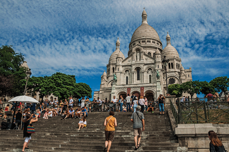 """Paris, France - July 08, 2017. People, staircase and Basilica of Sacre Coeur facade in Paris. Known as the """"City of Light"""", it is one of the most impressive cultural centers in the world. Northern France. Editorial"""