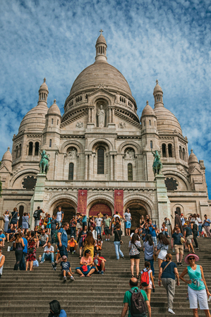 """Paris, France - July 08, 2017. People and Basilica of the Sacre Coeur facade in Paris. Known as the """"City of Light"""", it is one of the most impressive cultural centers in the world. Northern France. Retouched photo"""