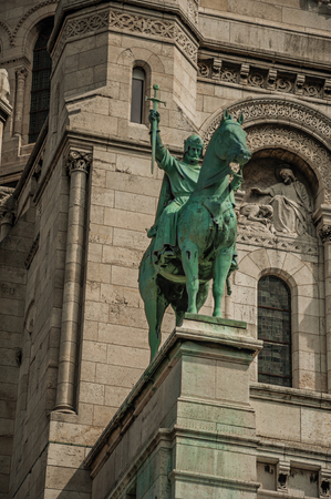 Bronze equestrian statue at the Basilica of Sacre Coeur facade in Paris. Known as the City of Light, it is one of the most impressive cultural centers in the world. Northern France.