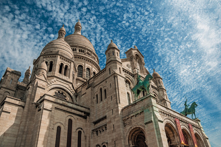 """Paris, France - July 08, 2017. Cloudy blue sky and Basilica of Sacre Coeur facade in Paris. Known as the """"City of Light"""", it is one of the most impressive cultural centers in the world. Northern France. Imagens"""