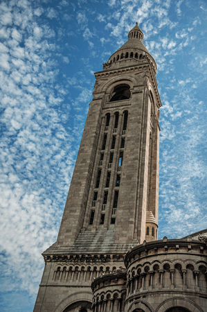 """Tall steeple and decoration at the Basilica of Sacre Coeur facade in Paris. Known as the """"City of Light"""", it is one of the most impressive cultural centers in the world. Northern France."""