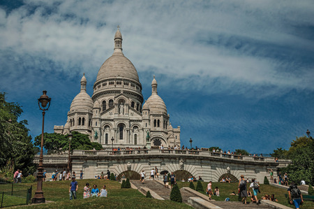 """Paris, France - July 08, 2017. People, staircase and Basilica of Sacre Coeur at Montmartre in Paris. Known as the """"City of Light"""", it is one of the world's most awesome cultural centers. Northern France. Editorial"""