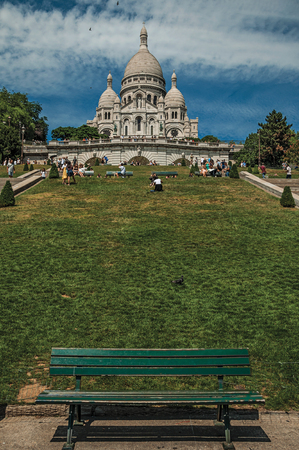 """Paris, France - July 08, 2017. People, lawn and Basilica of the Sacre Coeur at Montmartre in Paris. Known as the """"City of Light"""", it is one of the world's most awesome cultural centers. Northern France."""
