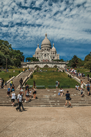 """Paris, France - July 08, 2017. People, staircase and Basilica of Sacre Coeur at Montmartre in Paris. Known as the """"City of Light"""", it is one of the world's most awesome cultural centers. Northern France."""