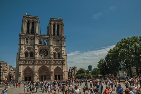 """Paris, France - July 08, 2017. People and gothic Notre-Dame Cathedral at Paris City Center. Known as the """"City of Light"""", it is one of the world's most awesome cultural centers. Northern France. Editorial"""