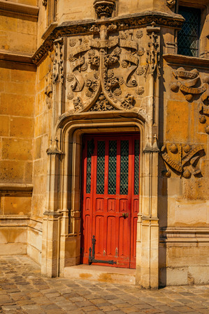Paris, northern France - July 08, 2017. Gothic door of Cluny Museum, with a collection of medieval art artifacts in Paris. Known as one of the world's most impressive cultural centers.