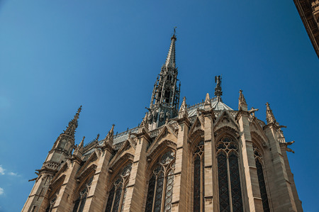 Close-up of side columns and towers of the gothic Sainte-Chapelle (church) under blue sky, in Paris. Known as the Editorial