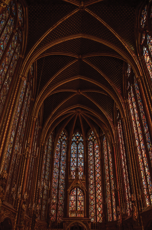 Paris, Northern France - July 08, 2017. Colorful stained glass windows at the gothic Sainte-Chapelle (church) in Paris. Known as the Editorial