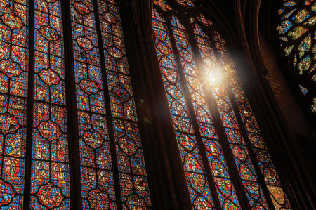 Paris, Northern France - July 08, 2017. Stained glass windows and sunlight at the Sainte-Chapelle (church) in Paris. Known as the