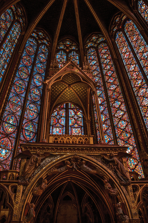 """Paris, Northern France - July 08, 2017. Stained glass windows and baldachin at the Sainte-Chapelle (church) in Paris. Known as the """"City of Light"""", it is one of the most awesome cultural center"""