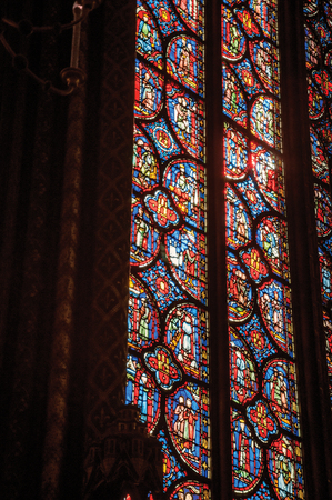 """Paris, Northern France - July 08, 2017. Detail of Stained glass window at the gothic Sainte-Chapelle (church) in Paris. Known as the """"City of Light"""", it is one of the most awesome cultural center Editorial"""