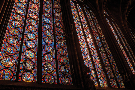 """Paris, Northern France - July 08, 2017. Colorful stained glass windows at the gothic Sainte-Chapelle (church) in Paris. Known as the """"City of Light"""", it is one of the most awesome cultural center"""