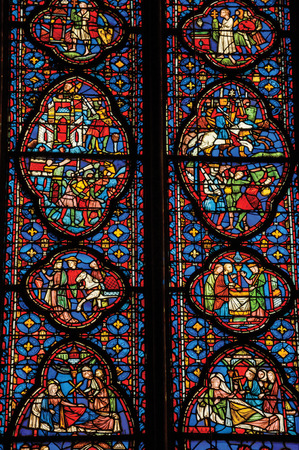 """Paris, Northern France - July 08, 2017. Detail of Stained glass window at the gothic Sainte-Chapelle (church) in Paris. Known as the """"City of Light"""", it is one of the most awesome cultural center"""