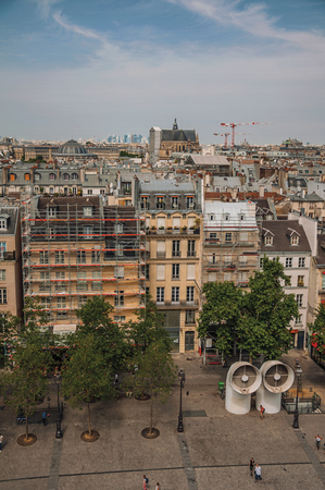 Buildings in square and cranes on the horizon seen from the Georges Pompidou Center in Paris. Known as the