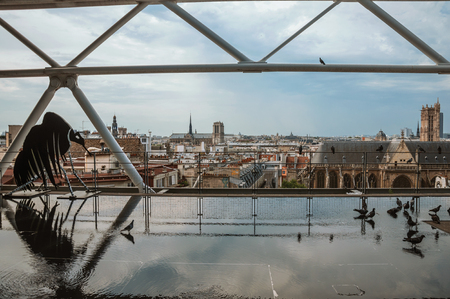 """Paris, northern France - July 09, 2017. Modern artwork and skyline from the Georges Pompidou Center at Paris. Known as the """"City of Light"""", it is one of the most impressive cultural centers in the world. Editorial"""