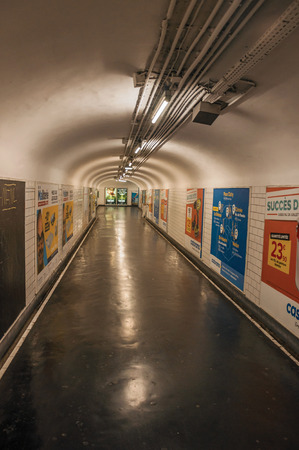 Paris, northern France - July 09, 2017. Advertising in passageway linking stations of the Paris Subway. Known as the