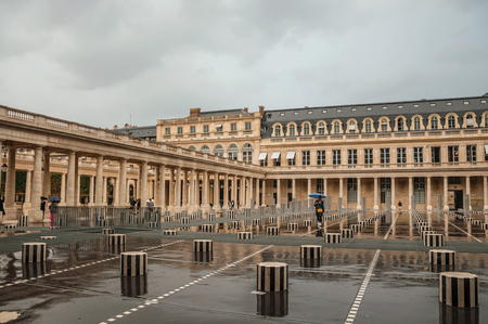 Paris, northern France - July 10, 2017. Building and inner courtyard on rainy day at the Palais-Royal in Paris. Known as the