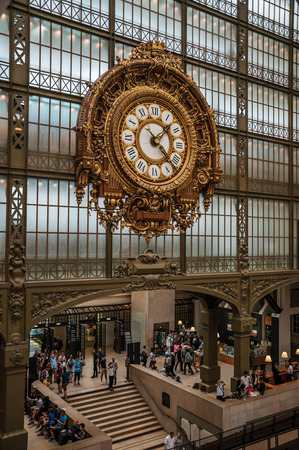 Paris, France - July 11, 2017. Golden clock view at the main hall of the Quai d'Orsay Museum in Paris. Known as the