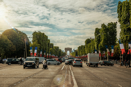 Paris, France - July 11, 2017. Trees and cars on the Champs-Elysees Avenue in Paris. Known as the City of Light, it is one of the worlds most awesome cultural centers. Northern France. Editorial