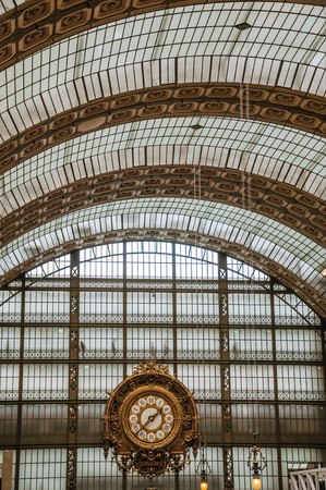 """Paris, France - July 11, 2017. Golden clock and ceiling at the Quai d'Orsay Museum main hall in Paris. Known as the """"City of Light"""", it is one of the world's most awesome cultural centers. Northern France"""