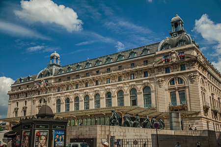 """Paris, France - July 11, 2017. People in front of the Quai d'Orsay Museum facade in Paris. Known as the """"City of Light"""", it is one of the world's most awesome cultural centers. Northern France."""