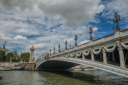 """Alexandre III bridge, Grand Palais building and boats anchored at Seine River bank in Paris. Known as the """"City of Light"""", it is one of the most impressive cultural centers in the world. Northern France. Imagens"""