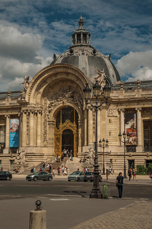 """Paris, France - July 11, 2017. People and street in front of the Petit Palais facade in Paris. Known as the """"City of Light"""", it is one of the most impressive cultural centers in the world. Northern France. Editorial"""