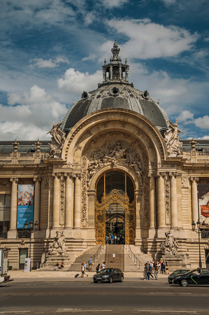 """Paris, France - July 11, 2017. People and street in front of the Petit Palais facade in Paris. Known as the """"City of Light"""", it is one of the most impressive cultural centers in the world. Northern France."""