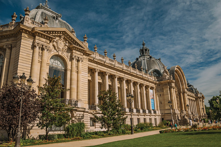 """Paris, France - July 11, 2017. People and garden in front of the Petit Palais in Paris. Known as the """"City of Light"""", it is one of the world's most awesome cultural centers. Northern France. Editorial"""