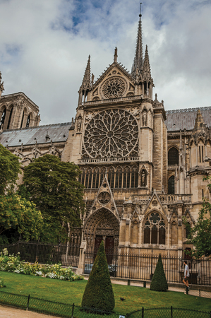 """Side of the gothic Cathedral of Notre-Dame in the City Center of Paris. Known as the """"City of Light"""", it is one of the most impressive cultural centers in the world."""