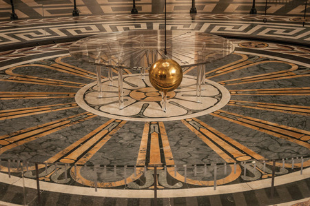 Paris, northern France - July 12, 2017. View of the famous Foucault Pendulum copper ball swinging inside the Pantheon in Paris. Known as one of the most impressive cultural world center Editorial
