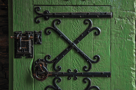 Detail of lock and hinge of iron on wooden door in Gravensteen Castle at Ghent. In addition to intense cultural life, the city is full of Gothic buildings and Flemish architecture. Northern Belgium.