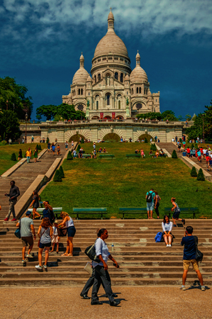 Paris, France - July 08, 2017. People, staircase and Sacre Coeur's Basilica in Paris. Known as the