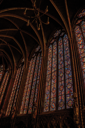 """Paris, Northern France - July 08, 2017. Colorful stained glass windows at the gothic Sainte-Chapelle (church) in Paris. Known as the """"City of Light"""", it is one of the most awesome cultural center Editorial"""