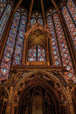 Paris, Northern France - July 08, 2017. Stained glass windows and baldachin at the Sainte-Chapelle (church) in Paris. Known as the