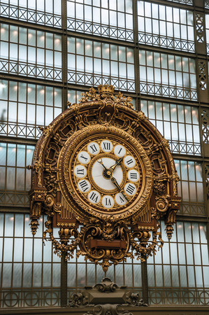 """Paris, France - July 11, 2017. Golden clock view at the main hall of the Quai d'Orsay Museum in Paris. Known as the """"City of Light"""", it is one of the world's most awesome cultural centers. Northern France"""