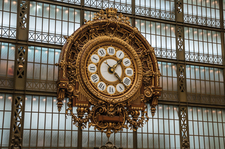 """Paris, France - July 11, 2017. Golden clock view at the main hall of the Quai d'Orsay Museum in Paris. Known as the """"City of Light"""", it is one of the world's most awesome cultural centers. Northern France Editorial"""