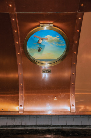 """Paris, northern France - July 09, 2017. Detail of porthole at Arts et Metiers subway station in Paris. Known as the """"City of Light"""", it is one of the most impressive cultural centers in the world."""