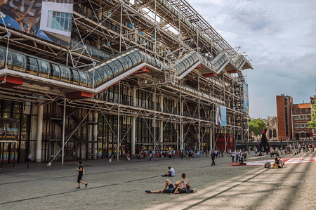 Paris, northern France - July 09, 2017. Facade and escalator of the Georges Pompidou Center in cloudy day at Paris. Known as the