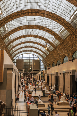 """Paris, France - July 11, 2017. People and art at the main hall of the Quai d'Orsay Museum in Paris. Known as the """"City of Light"""", it is one of the world's most awesome cultural centers. Northern France."""
