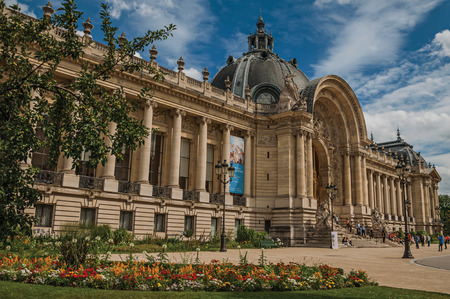 Paris, France - July 11, 2017. People and garden in front of the Petit Palais's facade in Paris. Known as the