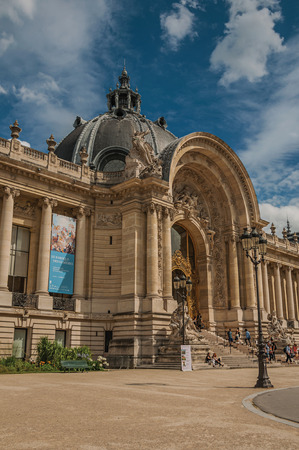Paris, France - July 11, 2017. People and garden in front of the Petit Palais's entrance in Paris. Known as the Editorial