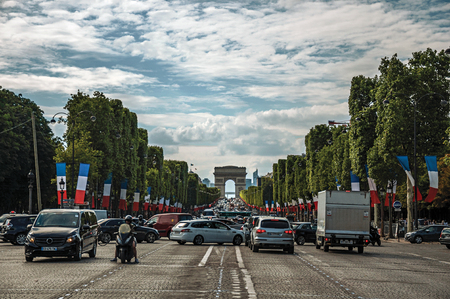 Paris, France - July 11, 2017. Trees and cars on the Champs-Elysees Avenue in Paris. Known as the