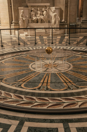 Paris, northern France - July 12, 2017. View of the famous Foucault Pendulum copper ball swinging inside the Pantheon in Paris. Known as one of the world's most impressive cultural centers.