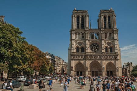 Paris, France - July 08, 2017. People and gothic Notre-Dame Cathedral at Paris City Center. Known as the