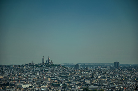 """Skyline, Sacre-Coeur Basilica and buildings under blue sky, seen from the Eiffel Tower in Paris. Known as the """"City of Light"""", it is one of the most impressive cultural centers in the world. Northern France. Imagens"""